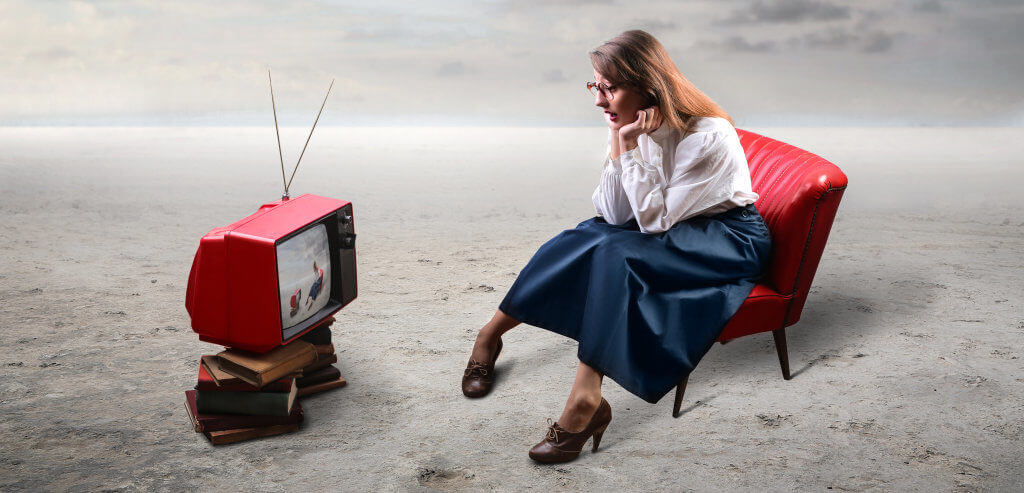Woman watching old tv outside