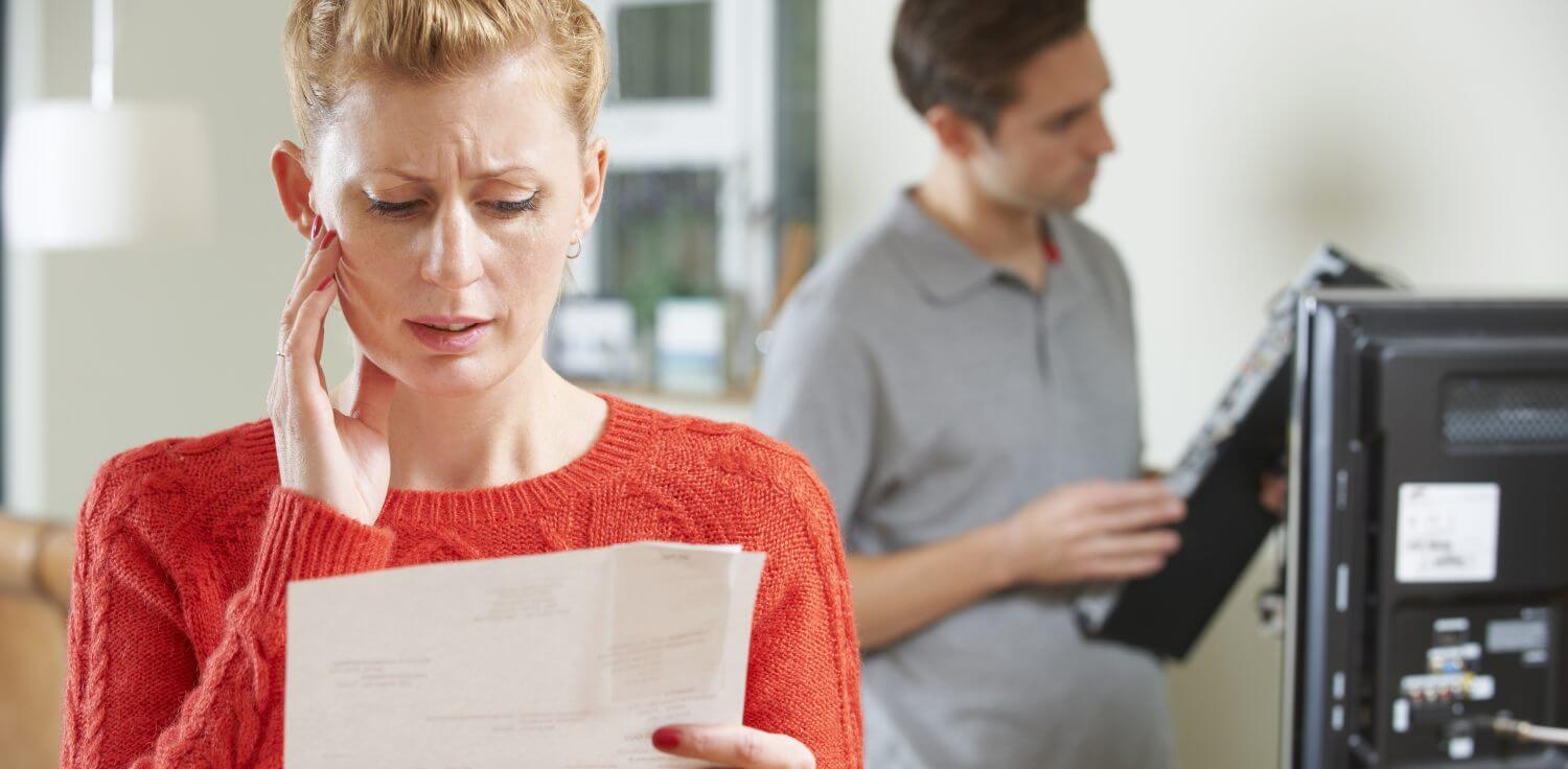 Woman looking at TV license fee bill