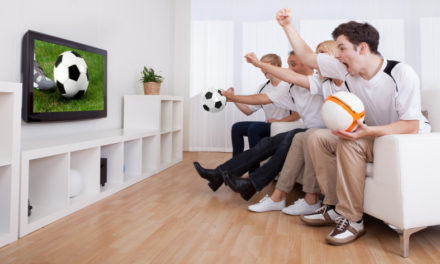 Family watching football on TV