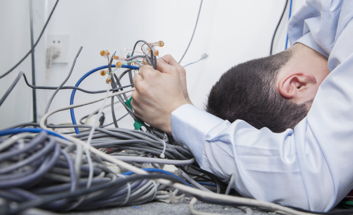 Man with tangled cables