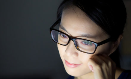 Woman glasses in front of screen