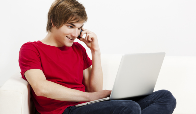Young Man with a computer and phone