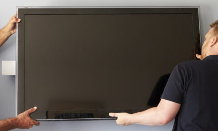 Men mounting a tv on the wall