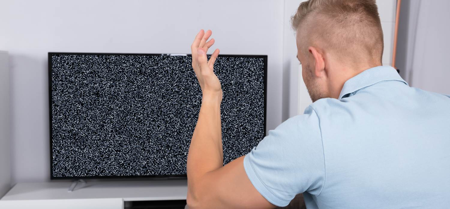 Man in front of TV with no signal