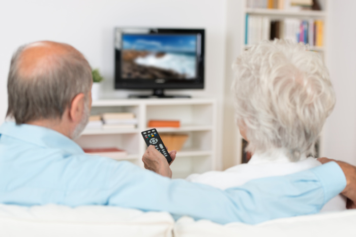 Elderly couple seniors watchingTV