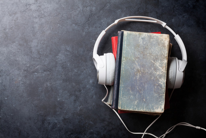 Audiobooks headphones and old book