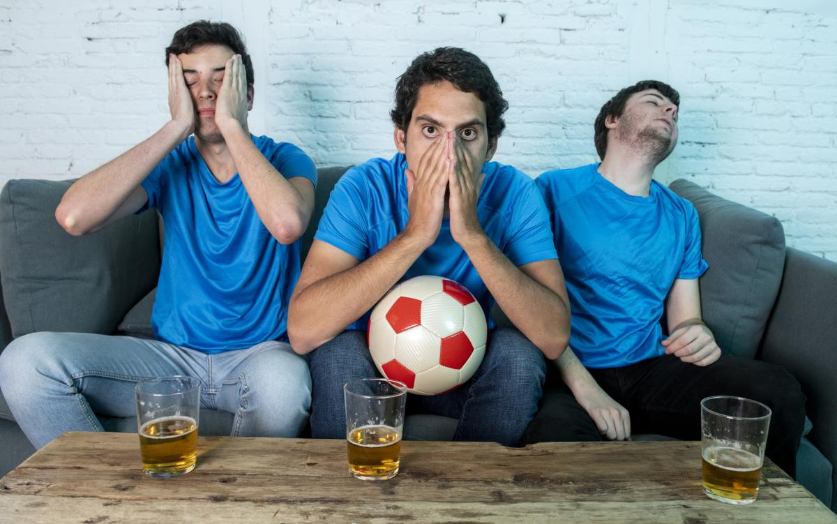 angry soccer fans watching tv 1200
