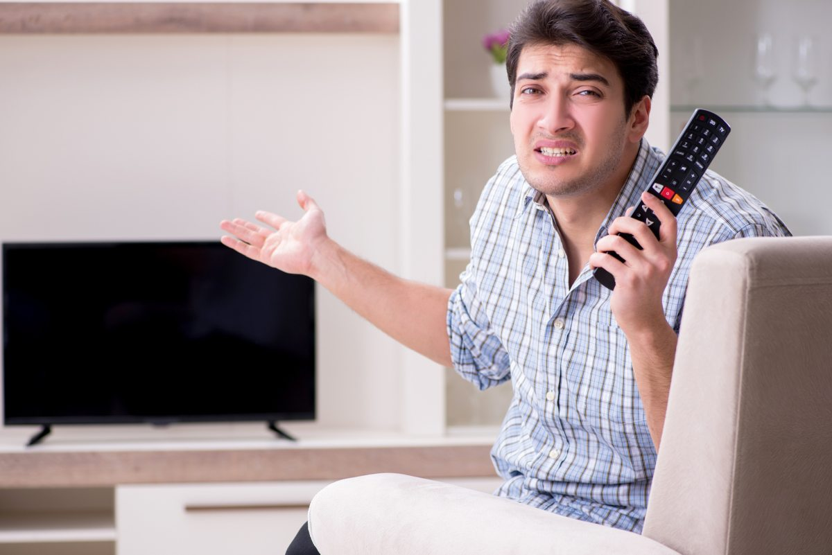 Man with tv remote confused 1200
