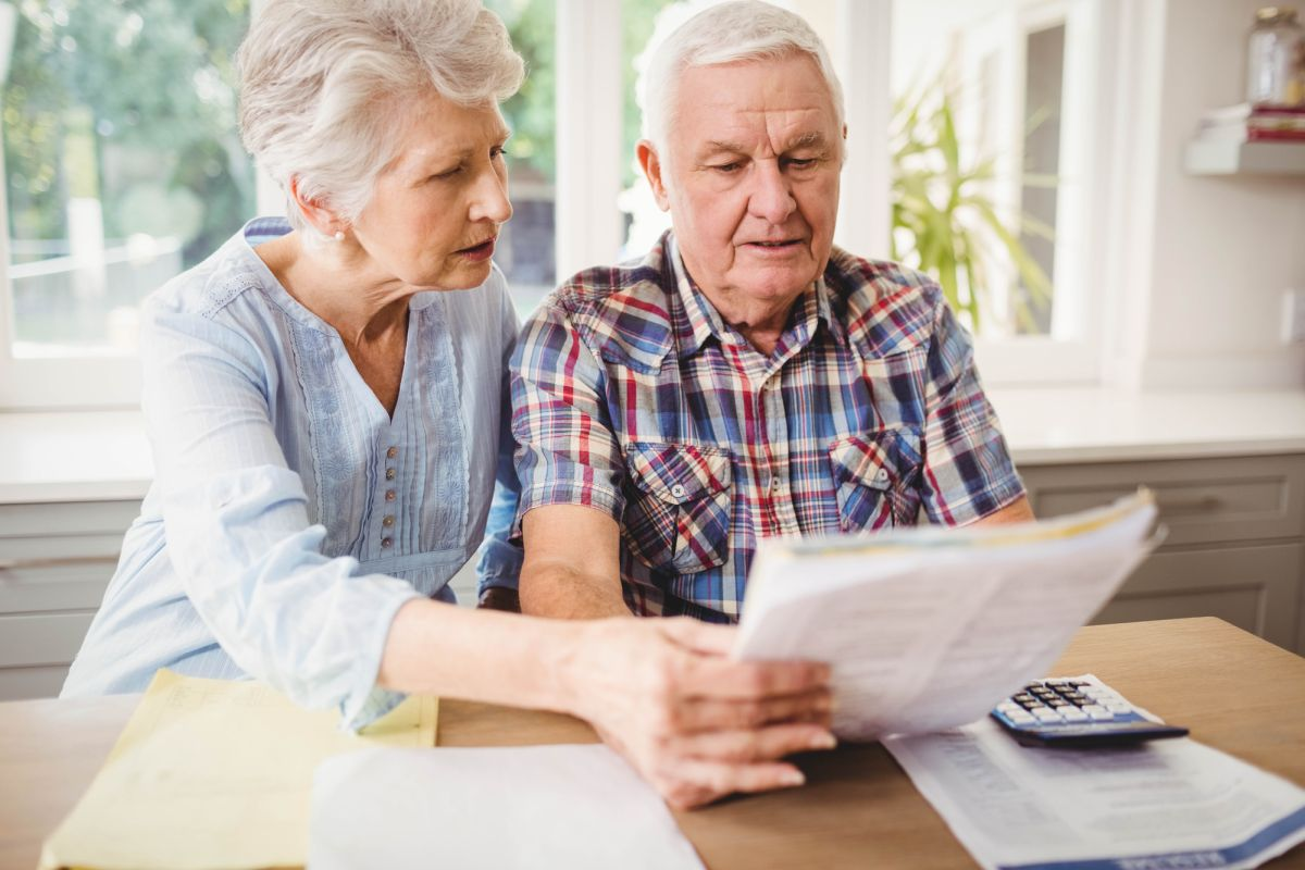 Senior couple checking bills