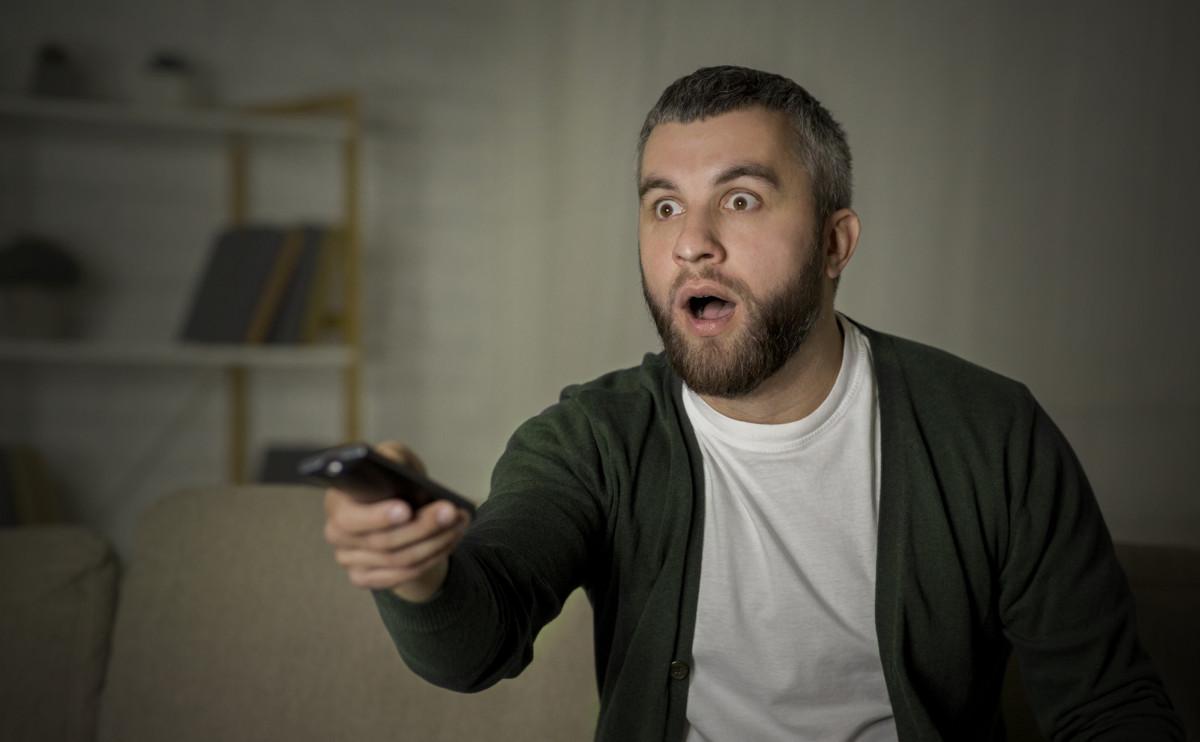 man watching TV shocked 1200